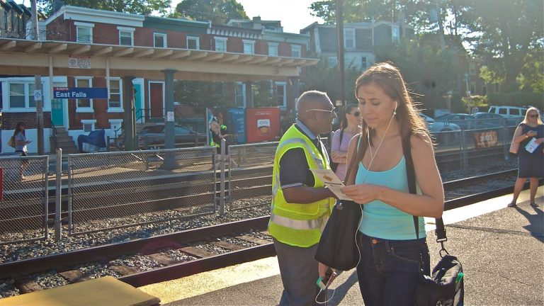 SEPTA safety officers handing out information to commuters on Thursday morning. (Emily Brooks/for NewsWorks)