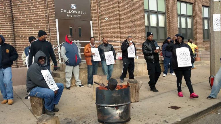 Striking SEPTA mechanics and bus operators picket outside the Callowhill Depot early this month. (Katie Colaneri/WHYY)