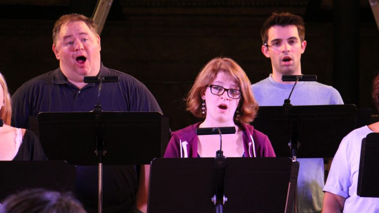 Members of The Crossing chamber choir rehearse for 'Seven Responses