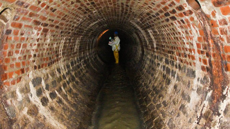 Wastewater pipeline infrastructure in Pennsylvania is old and in some cities pollutes rivers.  In Philadelphia about half of the wastewater system has brick piping. John Key Junior inspects a sewer in Philadelphia, Pa. (Kimberly Paynter/WHYY)