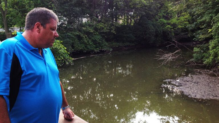 Hillsdale Fire Department Captain Tom Kelley looks out on Pascack Brook