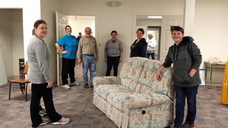 Volunteers move furniture into Family Promise of Lower Bucks' (FPLB) new day center in Tullytown