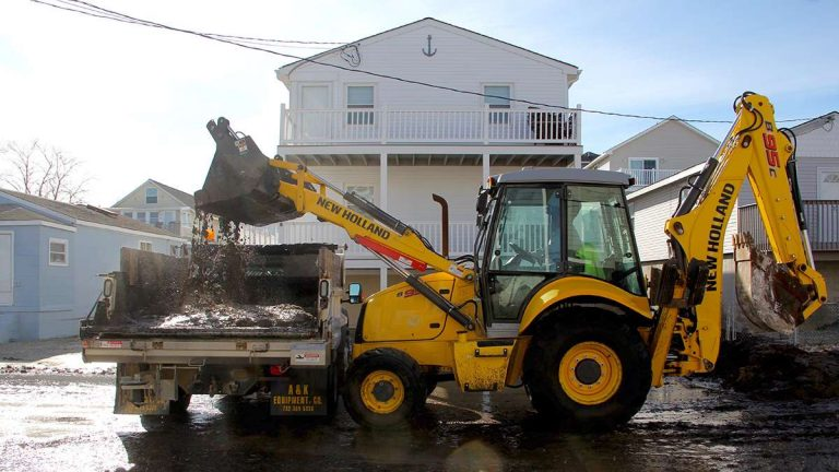 Bay Avenue in West Wildwood is cleared of mud and debris left by flooding from the back bay. (Emma Lee/WHYY)