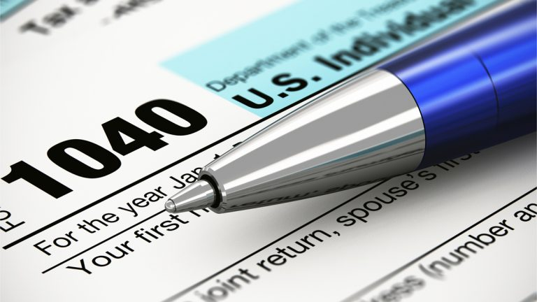 (a href='http://www.shutterstock.com/pic-124020775/stock-photo-tax-form-business-financial-concept-macro-view-of-individual-return-tax-form-and-blue-metal.html?src=csl_recent_image-1'>1040 tax form image</a> courtesy of Shutterstock.com)
