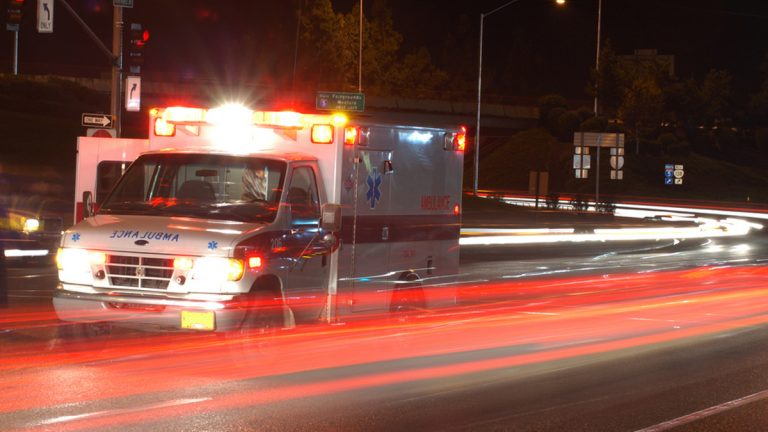 An ambulance is pictured on a highway