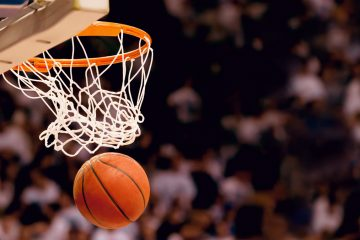 (<a href='http://www.shutterstock.com/pic-173318291/stock-photo-scoring-the-winning-points-at-a-basketball-game.html?src=csl_recent_image-1&ws=1'>Basketball image</a> courtesy of Shutterstock.com)