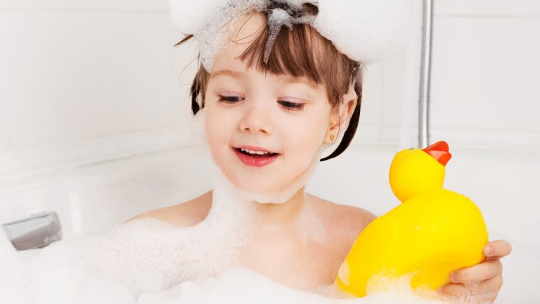 (<a href='http://www.shutterstock.com/pic-66659407/stock-photo-beautiful-little-girl-taking-a-relaxing-bath-with-foam-and-playing-with-a-toy-duck.html?src=csl_recent_image-2&ws=1'>Bubble bath</a> image courtesy of Shutterstock.com)