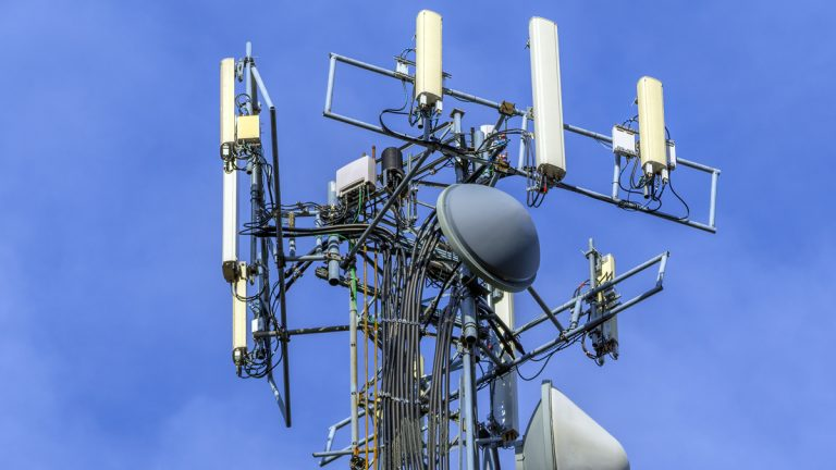 (<a href='http://www.shutterstock.com/pic-122758183/stock-photo-telecommunications-equipment-directional-mobile-phone-antenna-dishes-wireless-communication.html'>Cell tower</a> image courtesy of Shutterstock.com)