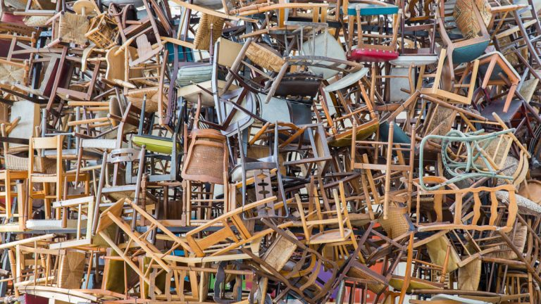 (<a href='http://www.shutterstock.com/pic-173998640/stock-photo-hundreds-of-vintage-chairs-stacked-in-a-pile.html'>Dangerous chairs</a> image courtesy  of Shutterstock.com)