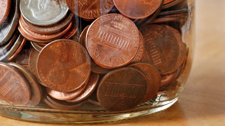 (<a href='http://www.shutterstock.com/pic-16349485/stock-photo-glass-jar-filled-with-american-coins-extreme-closeup-ideal-as-background.html'>Coin jar</a> image courtesy of Shutterstock.com)
