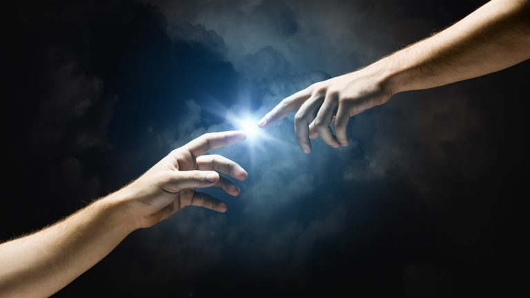 (<a href='http://www.shutterstock.com/pic-152934551/stock-photo-michelangelo-god-s-touch-close-up-of-human-hands-touching-with-fingers.html'>The touch of God</a> image courtesy of Shutterstock.com)