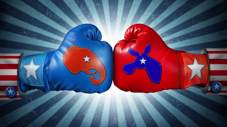 (<a href='http://www.shutterstock.com/pic-116560858/stock-photo-american-election-fight-as-republican-versus-democrat-as-two-boxing-gloves-with-the-elephant-and.html'>Image</a> courtesy of Shutterstock.com)
