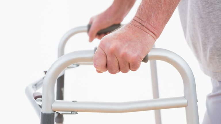 <a href='http://www.shutterstock.com/pic-257070058/stock-photo-senior-man-walking-with-zimmer-frame.html'>Elder care</a> image courtesy of Shutterstock.com)