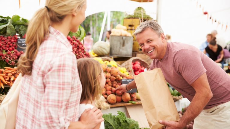(a href='http://www.shutterstock.com/pic-267549392/stock-photo-family-buying-fresh-vegetables-at-farmers-market-stall.html'>Farmers market image</a> courtesy of Shutterstock.com)