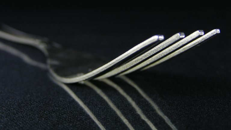 (<a href='http://www.shutterstock.com/pic-173833/stock-photo-fork-on-black.html?src=csl_recent_image-1'>Fork on black tablecloth</a> image courtesy of Shutterstock.com)