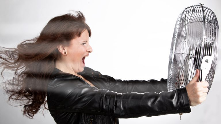 (<a href='http://www.shutterstock.com/pic-205679977/stock-photo-beautiful-woman-is-screaming-with-a-ventilator-in-your-hands.html'>Woman screaming into a fan</a> image courtesy of Shutterstock.com)