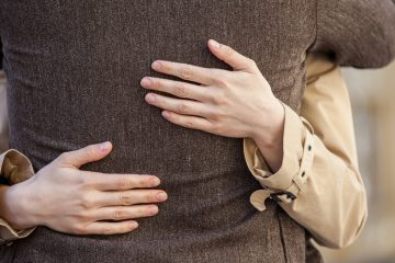 (<a href='http://www.shutterstock.com/pic-223911598/stock-photo-adult-couple-standing-on-street-and-hugging-closeup-of-woman-hands-hugging-man-outside.html?src=csl_recent_image-1'>Hug</a> image courtesy of Shutterstock.com)