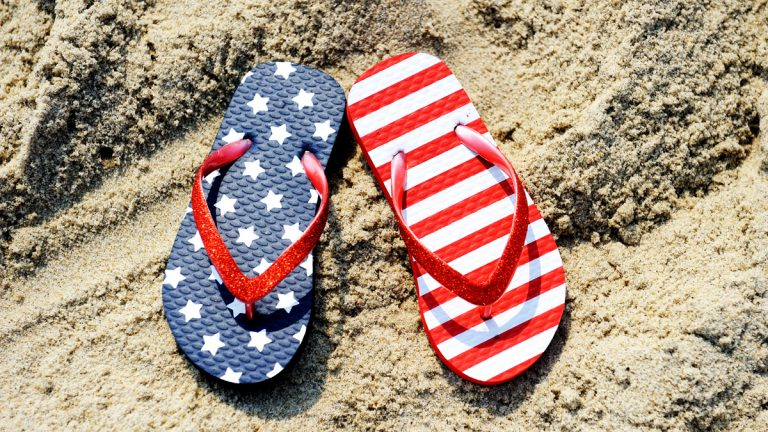 (<a href='http://www.shutterstock.com/pic-79755328/stock-photo-pair-of-flip-flop-on-sand-of-jersey-shore-with-usa-flag-pattern-on-it.html'>Flip-flops on sand image</a> courtesy of Shutterstock.com)
