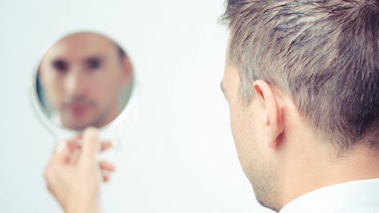 (<a href='http://www.shutterstock.com/pic-158268752/stock-photo-ego-man-reflection-in-mirror-on-a-white-background.html'>Man and mirror</a> image courtesy of Shutterstock.com)