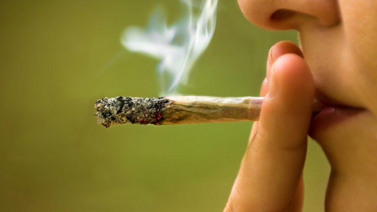 (<a href='http://www.shutterstock.com/pic-157734158/stock-photo-girl-smoking-marijuana-close-up.html'>Marijuana</a> courtesy of Shutterstock.com)