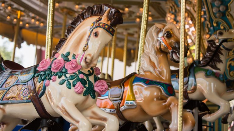 (<a href='http://www.shutterstock.com/pic-126620390/stock-photo-carousel-horses-on-a-carnival-merry-go-round.html'>Carousel image</a> courtesy of Shutterstock.com)