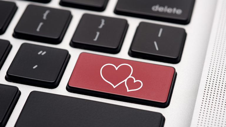 (<a href='http://www.shutterstock.com/pic-109782713/stock-photo-online-dating-on-computer-keyboard.html'>Online dating</a> image courtesy of Shuttrerstock.com)