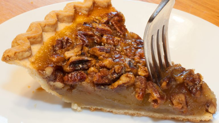 (<a href='http://www.shutterstock.com/pic-235870087/stock-photo-fork-going-into-a-piece-of-pecan-pie-on-a-white-plate.html'>Pecan pie image</a> courtesy of Shutterstock.com)