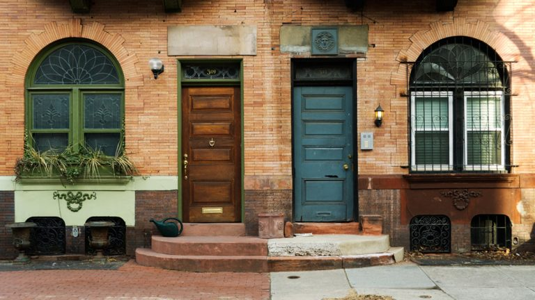 (<a href='http://www.shutterstock.com/pic-2928803/stock-photo-near-symmetry-between-two-front-doors-side-by-side-philadelphia-pa.html'>Neighbors image</a> courtesy of Shutterstock.com)