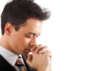 (<a href='http://www.shutterstock.com/pic-81281836/stock-photo-young-businessman-praying-isolated-against-white-background.html'>Businessman praying</a> image courtesy of Shutterstock.com)