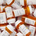 Prescription drug bottles are pictured overhead