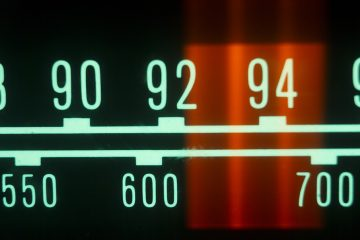 (<a href='http://www.shutterstock.com/pic-122048020/stock-photo-a-glowing-radio-with-the-marker-running-through-the-different-stations-and-frequencies.html?src=csl_recent_image-1'>Radio dial image</a> courtesy of Shutterstock.com)