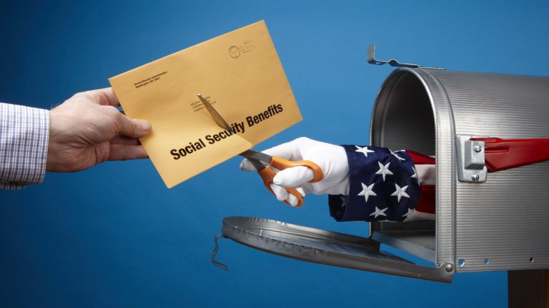 (<a href='http://www.shutterstock.com/pic-90330385/stock-photo-uncle-sam-comes-out-of-mailbox-to-cut-social-security-envelope-includes-space-for-copy.html'>Image</a> courtesy of Shutterstock.com)
