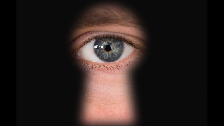 (<a href='http://www.shutterstock.com/pic-246706546/stock-photo-close-up-photo-of-person-s-seen-through-keyhole.html'>Spying</a> image courtesy of Shutterstock.com)