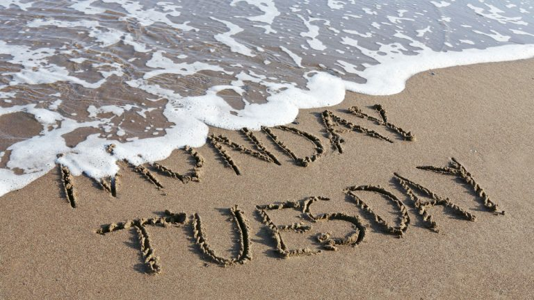 (<a href='http://www.shutterstock.com/pic-181801145/stock-photo-tuesday-is-coming-concept-inscription-monday-and-tuesday-written-on-a-sandy-beach-the-wave-is.html'>Image courtesy of Shutterstock.com</a>)