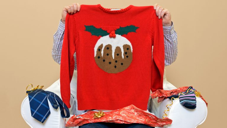 (<a href='http://www.shutterstock.com/pic-165510479/stock-photo-a-man-opening-christmas-presents-to-discover-he-got-a-christmas-themed-jumper-to-go-along-with-the.html'>Ugly sweater</a> image courtesy of Shutterstock.com)