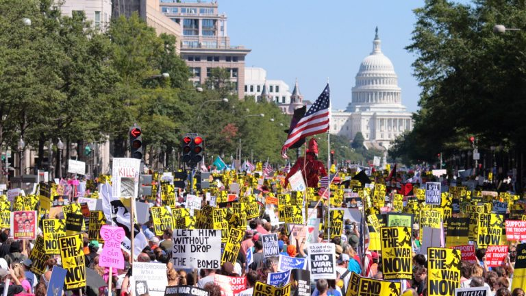 (<a href='http://www.shutterstock.com/pic-97531688/stock-photo-washington-dc-a-mass-of-anti-war-protestors-march-down-pennsylvania-ave-toward-the-capitol.html'>War protest</a> image courtesy of Shutterstock.com)
