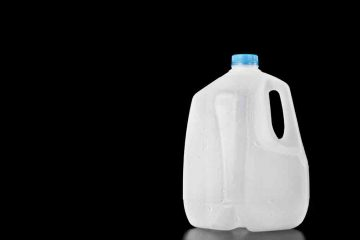 (<a href='http://www.shutterstock.com/pic-45974677/stock-photo-plastic-recyclable-water-milk-or-juice-bottle-of-one-gallon-with-water-drops-on-the-surface.html?src=csl_recent_image-1'>Gallon jug</a> courtesy of Shutterstock.com)