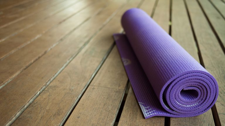 (<a href='http://www.shutterstock.com/pic-130781543/stock-photo-yoga-mat.html'>Yoga mat</a> image courtesy of Shutterstock.com