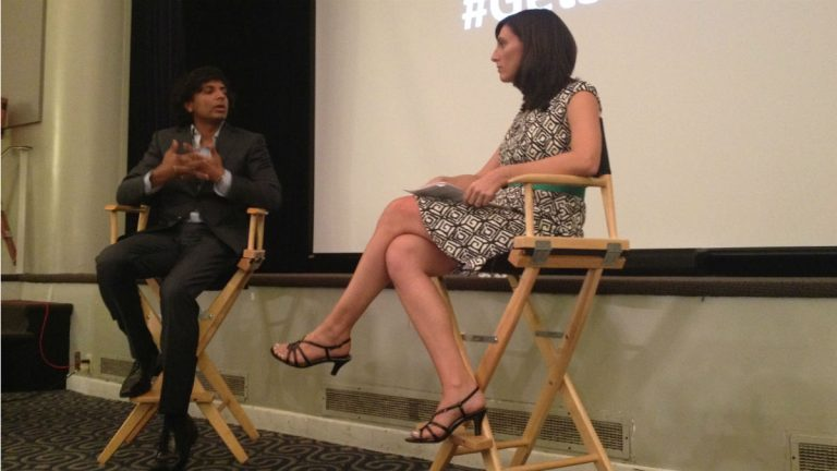 M. Night Shyamalan (left) talks education with Delaware teacher of the year Megan Szabo. (Avi Wolfman-Arent, NewsWorks/WHYY)
