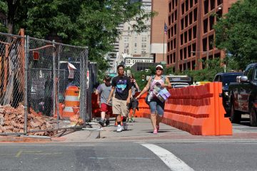 Demolition at Third and Market streets drives pedestrians into traffic lanes. (Emma Lee/WHYY)