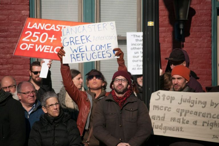 About 250 people demonstrated in support of refugee resettlement as a counter to a protest staged outside Church World Service's office in Lancaster. (Diana Robinson/WITF)