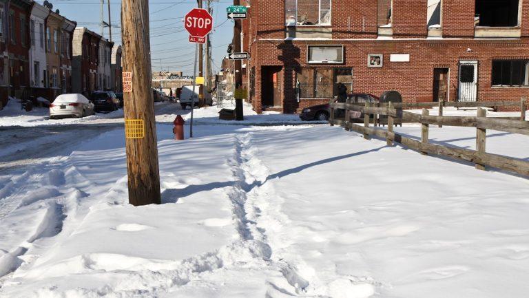 A sidewalk is not shoveled in South Philadelphia Thursday morning. (Kimberly Paynter/WHYY)