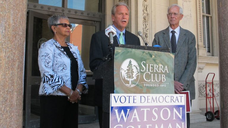 New Jersey Sierra Club director Jeff Tittel, center, announces the Sierra Club's endorsement of Assemblywoman Bonnie Watson Coleman for Congress on the  steps of the Statehouse in Trenton.(Phil Gregory/WHYY)