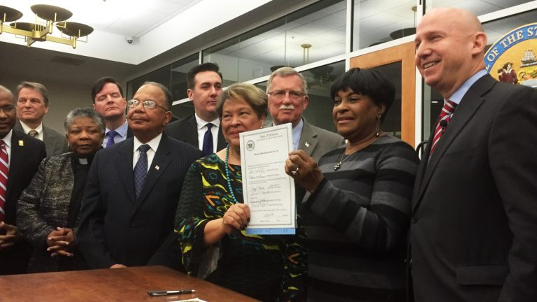 Gov. Jack Markell signed a resolution Wednesday apologizing for Delaware's historic role in slavery.