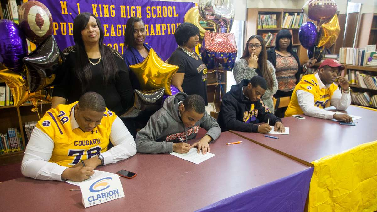 MLK High School football players on National Signing Day. (Brad Larrison/for NewsWorks)
