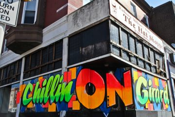 Artist Stephen Powers and developer David Waxman are changing the landscape of Girard Avenue one hand-painted sign at a time. (Kimberly Paynter/WHYY)