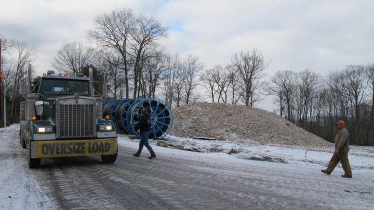 An oversize truck load of natural gas equipment moves slowly along an icy mountain road in the Tiadaghton state forest(Marie Cusick/ StateImpact Pennsylvania)