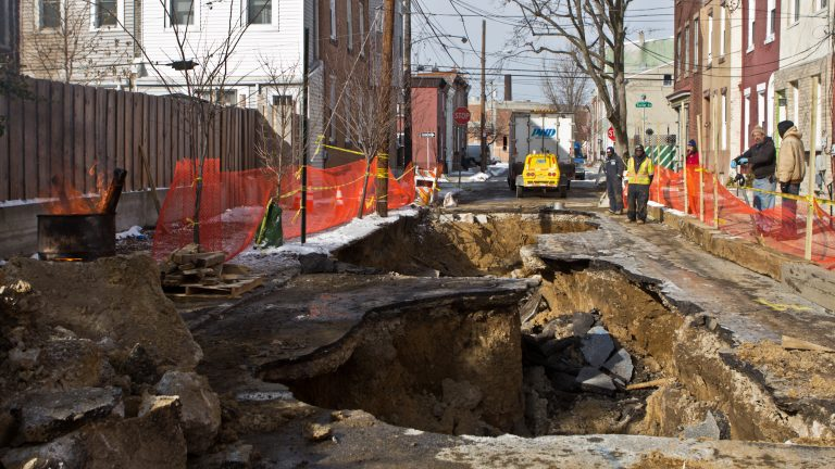 A sinkhole is under repair at the 2300 block of East Boston Street. (Kimberly Paynter/WHYY)