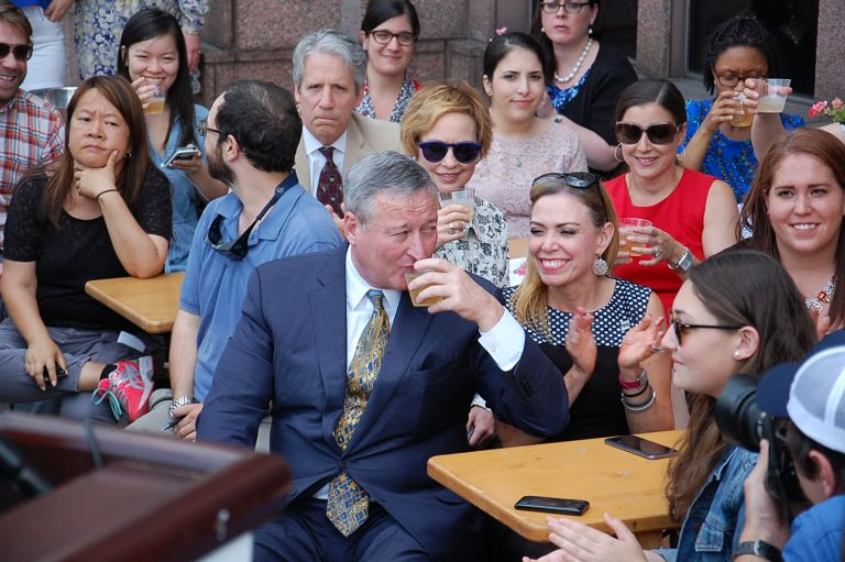Mayor Kenney joins a crowd toasting efforts to keep residents in town during the Democratic National Convention.  (Tom MacDonald/ WHYY)