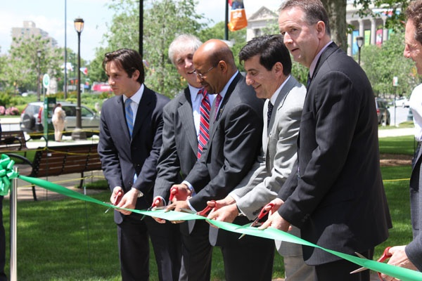 Mayor Michael Nutter (center) cuts the ribbon on Sister Cities Park. (Emma Jacobs/WHYY)